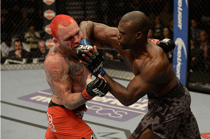 LAS VEGAS, NV - DECEMBER 28:  (R-L) Uriah Hall elbows Chris Leben in their middleweight bout during the UFC 168 event at the MGM Grand Garden Arena on December 28, 2013 in Las Vegas, Nevada. (Photo by Donald Miralle/Zuffa LLC/Zuffa LLC via Getty Images) *** Local Caption *** Chris Leben; Uriah Hall