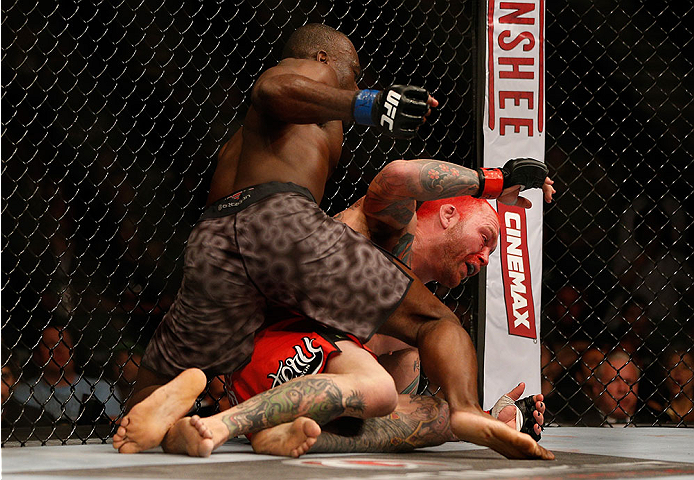 LAS VEGAS, NV - DECEMBER 28:  (L-R) Uriah Hall punches Chris Leben in their middleweight bout during the UFC 168 event at the MGM Grand Garden Arena on December 28, 2013 in Las Vegas, Nevada. (Photo by Josh Hedges/Zuffa LLC/Zuffa LLC via Getty Images) *** Local Caption *** Chris Leben; Uriah Hall