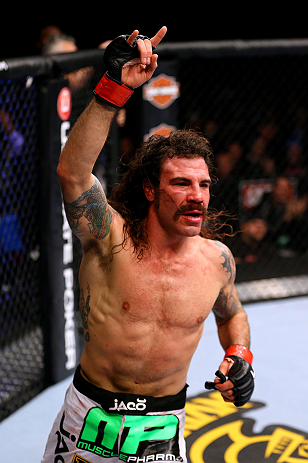 CHICAGO, IL - JANUARY 26:  Clay Guida celebrates defeating Hatsu Hioki during their Featherweight Bout part of UFC on FOX at United Center on January 26, 2013 in Chicago, Illinois.  (Photo by Al Bello/Zuffa LLC/Zuffa LLC Via Getty Images)