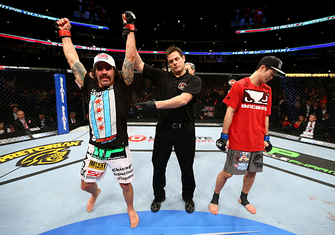 CHICAGO, IL - JANUARY 26:  Clay Guida (L) celebrates defeating Hatsu Hioki (R) during their Featherweight Bout part of UFC on FOX at United Center on January 26, 2013 in Chicago, Illinois.  (Photo by Al Bello/Zuffa LLC/Zuffa LLC Via Getty Images)