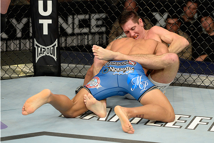 FORT CAMPBELL, KENTUCKY - NOVEMBER 6:  Steven Siler (top) attempts to submit Dennis Bermudez in their UFC featherweight bout on November 6, 2013 in Fort Campbell, Kentucky. (Photo by Jeff Bottari/Zuffa LLC/Zuffa LLC via Getty Images) *** Local Caption ***Dennis Bermudez; Steven Siler