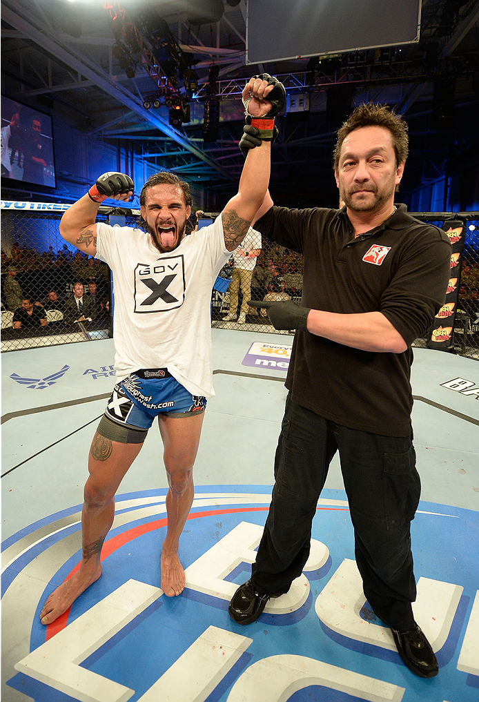 FORT CAMPBELL, KENTUCKY - NOVEMBER 6:  Dennis Bermudez (left) reacts to being declared the winner over Steven Siler in their UFC featherweight bout on November 6, 2013 in Fort Campbell, Kentucky. (Photo by Jeff Bottari/Zuffa LLC/Zuffa LLC via Getty Images) *** Local Caption ***Dennis Bermudez