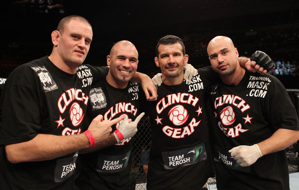 SYDNEY, AUSTRALIA - MARCH 03:  Anthony Perosh (second from right) poses for a photo with his trainers after defeating Nick Penner in a light heavyweight bout during the UFC on FX event at Allphones Arena on March 3, 2012 in Sydney, Australia.  (Photo by Josh Hedges/Zuffa LLC/Zuffa LLC via Getty Images) *** Local Caption *** Anthony Perosh; Elvis Sinosic