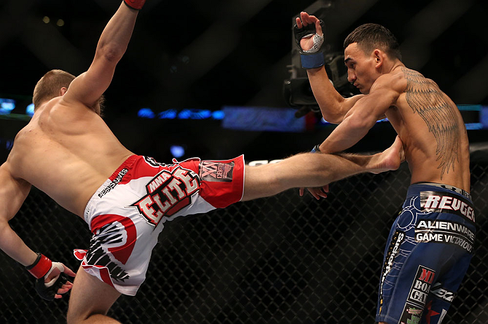 DENVER, CO - AUGUST 11:  (L-R) Justin Lawrence kicks Max Holloway during their featherweight bout at UFC 150 inside Pepsi Center on August 11, 2012 in Denver, Colorado. (Photo by Josh Hedges/Zuffa LLC/Zuffa LLC via Getty Images)