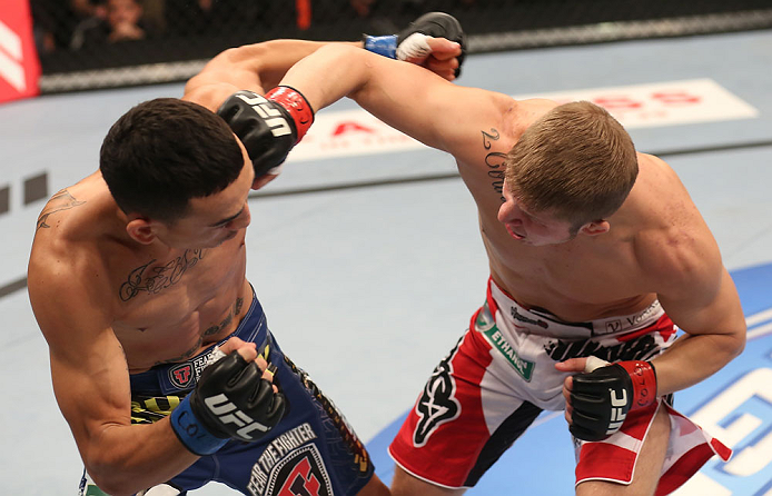 DENVER, CO - AUGUST 11:  (R-L) Justin Lawrence punches Max Holloway during their featherweight bout at UFC 150 inside Pepsi Center on August 11, 2012 in Denver, Colorado. (Photo by Nick Laham/Zuffa LLC/Zuffa LLC via Getty Images)