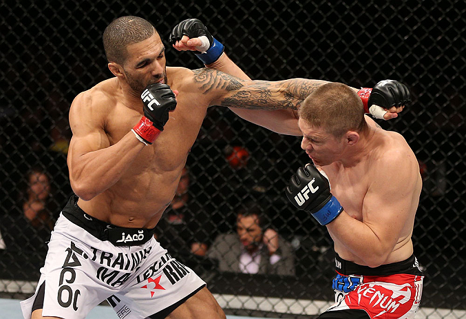 NOTTINGHAM, ENGLAND - SEPTEMBER 29:  (L-R) Che Mills and Duane Ludwig trade punches during their welterweight fight at the UFC on Fuel TV event at Capital FM Arena on September 29, 2012 in Nottingham, England.  (Photo by Josh Hedges/Zuffa LLC/Zuffa LLC via Getty Images)