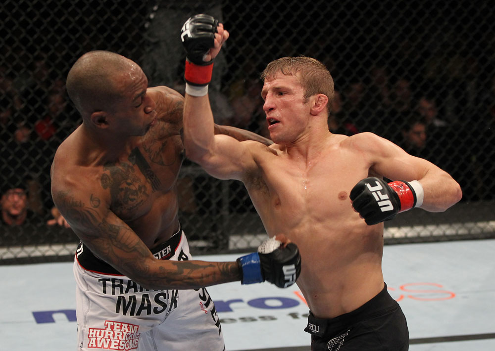OMAHA, NE - FEBRUARY 15:  (R-L) TJ Dillashaw punches Walel Watson during the UFC on FUEL TV event at Omaha Civic Auditorium on February 15, 2012 in Omaha, Nebraska.  (Photo by Josh Hedges/Zuffa LLC/Zuffa LLC via Getty Images) *** Local Caption *** TJ Dillashaw; Walel Watson
