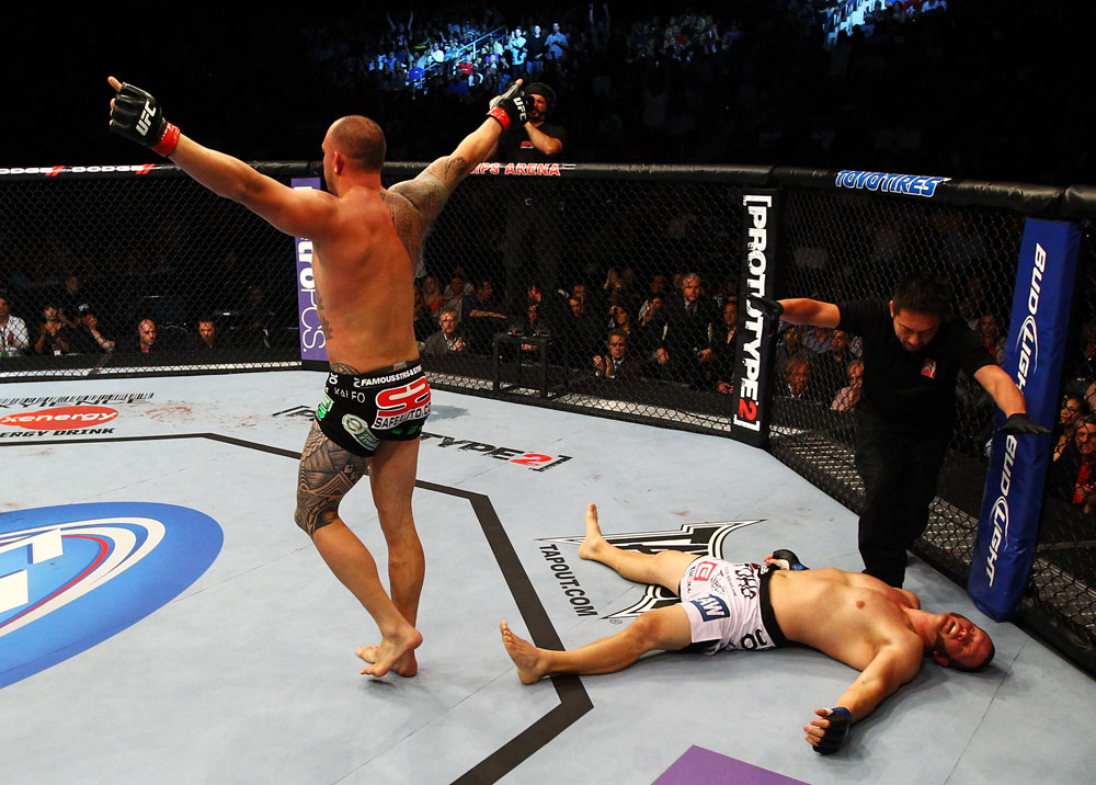 ATLANTA, GA - APRIL 21:  Travis Browne (L) celebrates after Chad Griggs (R) tapped out during their heavyweight bout for UFC 145 at Philips Arena on April 21, 2012 in Atlanta, Georgia.  (Photo by Al Bello/Zuffa LLC/Zuffa LLC via Getty Images)
