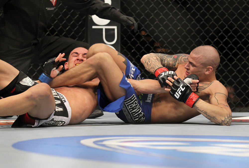 LAS VEGAS, NV - FEBRUARY 04:  Dustin Poirier (blue shorts) attempts to submit Max Holloway during the UFC 143 event at Mandalay Bay Events Center on February 4, 2012 in Las Vegas, Nevada.  (Photo by Josh Hedges/Zuffa LLC/Zuffa LLC via Getty Images) *** Local Caption *** Dustin Poirier; Max Holloway