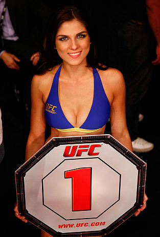 SAO PAULO, BRAZIL - JANUARY 19:  UFC Octagon Girl Aline Caroline Franzoi prepares to introduce a round during the UFC on FX event on January 19, 2013 at Ibirapuera Gymnasium in Sao Paulo, Brazil. (Photo by Josh Hedges/Zuffa LLC/Zuffa LLC via Getty Images)