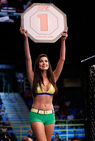 SAO PAULO, BRAZIL - JANUARY 19:  UFC Octagon Girl Camila Rodrigues de Oliveira introduces a round during the UFC on FX event on January 19, 2013 at Ibirapuera Gymnasium in Sao Paulo, Brazil. (Photo by Josh Hedges/Zuffa LLC/Zuffa LLC via Getty Images)