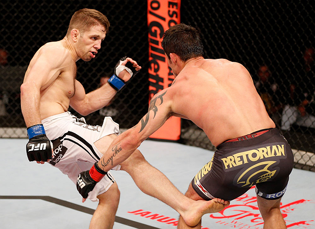 SAO PAULO, BRAZIL - JANUARY 19:  (L-R) Nik Lentz kicks Diego Nunes in their featherweight fight at the UFC on FX event on January 19, 2013 at Ibirapuera Gymnasium in Sao Paulo, Brazil. (Photo by Josh Hedges/Zuffa LLC/Zuffa LLC via Getty Images)