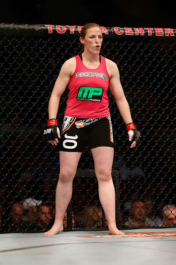 HOUSTON, TEXAS - OCTOBER 19:  Sarah Kaufman stands in her corner before facing Jessica Eye (not pictured) in their UFC women's bantamweight bout at the Toyota Center on October 19, 2013 in Houston, Texas. (Photo by Josh Hedges/Zuffa LLC/Zuffa LLC via Getty Images)