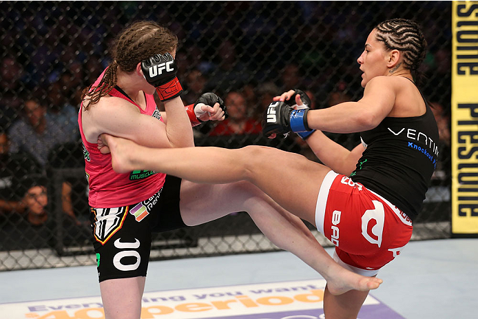 HOUSTON, TEXAS - OCTOBER 19:  (R-L) Jessica Eye kicks Sarah Kaufman in their UFC women's bantamweight bout at the Toyota Center on October 19, 2013 in Houston, Texas. (Photo by Nick Laham/Zuffa LLC/Zuffa LLC via Getty Images)