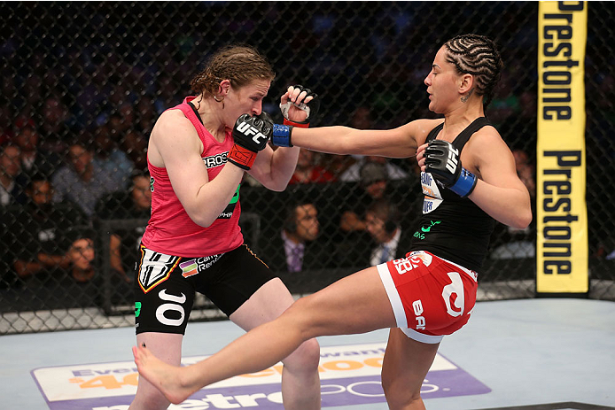 HOUSTON, TEXAS - OCTOBER 19:  (R-L) Jessica Eye punches Sarah Kaufman in their UFC women's bantamweight bout at the Toyota Center on October 19, 2013 in Houston, Texas. (Photo by Nick Laham/Zuffa LLC/Zuffa LLC via Getty Images)