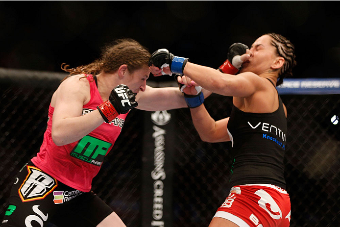 HOUSTON, TEXAS - OCTOBER 19:  (L-R) Sarah Kaufman punches Jessica Eye in their UFC women's bantamweight bout at the Toyota Center on October 19, 2013 in Houston, Texas. (Photo by Josh Hedges/Zuffa LLC/Zuffa LLC via Getty Images)