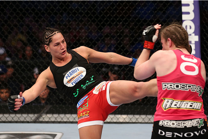 HOUSTON, TEXAS - OCTOBER 19:  (L-R) Jessica Eye kicks Sarah Kaufman in their UFC women's bantamweight bout at the Toyota Center on October 19, 2013 in Houston, Texas. (Photo by Nick Laham/Zuffa LLC/Zuffa LLC via Getty Images)