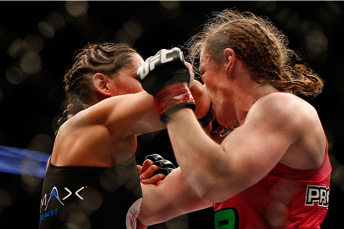 HOUSTON, TEXAS - OCTOBER 19:  (L-R) Jessica Eye elbows Sarah Kaufman in their UFC women's bantamweight bout at the Toyota Center on October 19, 2013 in Houston, Texas. (Photo by Josh Hedges/Zuffa LLC/Zuffa LLC via Getty Images)