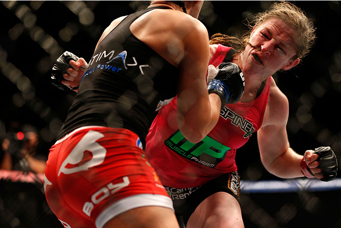 HOUSTON, TEXAS - OCTOBER 19:  (R-L) Sarah Kaufman punches Jessica Eye in their UFC women's bantamweight bout at the Toyota Center on October 19, 2013 in Houston, Texas. (Photo by Josh Hedges/Zuffa LLC/Zuffa LLC via Getty Images)
