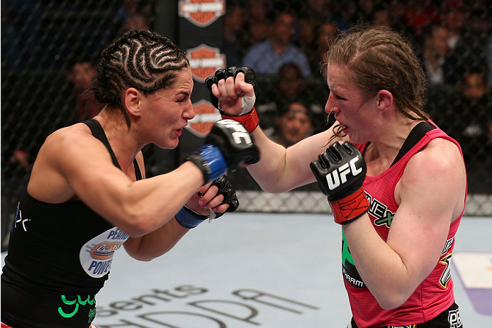 HOUSTON, TEXAS - OCTOBER 19:  (L-R) Jessica Eye and Sarah Kaufman exchange punches in their UFC women's bantamweight bout at the Toyota Center on October 19, 2013 in Houston, Texas. (Photo by Nick Laham/Zuffa LLC/Zuffa LLC via Getty Images)
