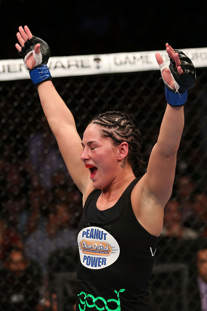 HOUSTON, TEXAS - OCTOBER 19:  Jessica Eye celebrates after defeating Sarah Kaufman (not pictured) in their UFC women's bantamweight bout at the Toyota Center on October 19, 2013 in Houston, Texas. Jessica Eye won by split decision. (Photo by Nick Laham/Zuffa LLC/Zuffa LLC via Getty Images)