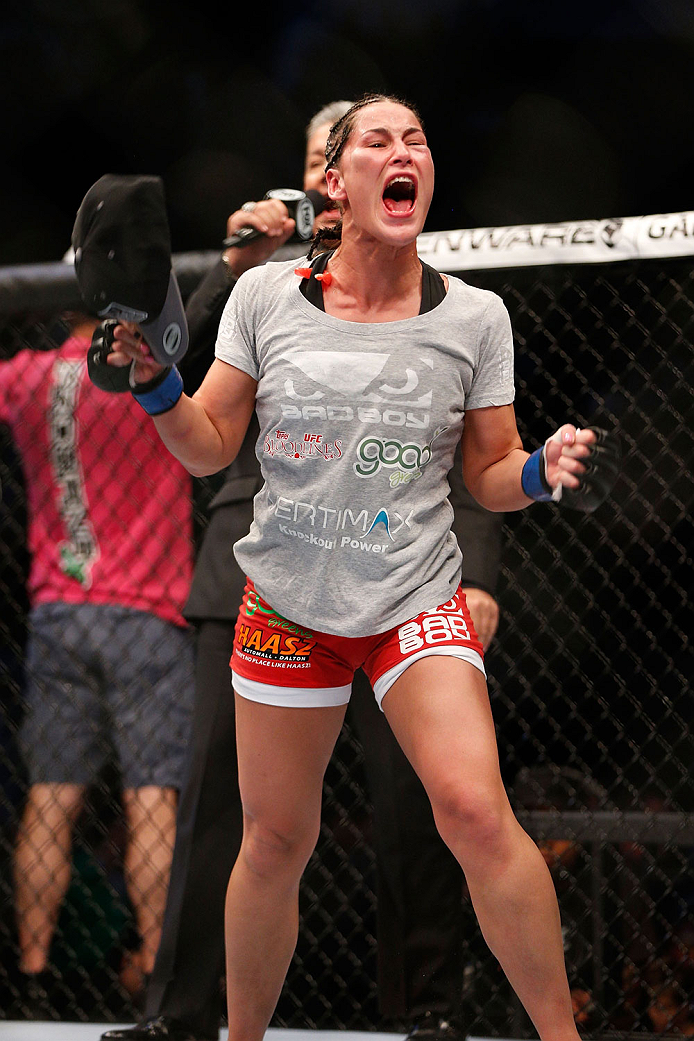 HOUSTON, TEXAS - OCTOBER 19:  Jessica Eye celebrates after defeating Sarah Kaufman (not pictured) by split decision in their UFC women's bantamweight bout at the Toyota Center on October 19, 2013 in Houston, Texas. (Photo by Josh Hedges/Zuffa LLC/Zuffa LLC via Getty Images)