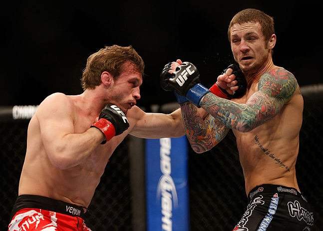 LAS VEGAS, NV - DECEMBER 29:  (L-R) Brad Pickett punches Eddie Wineland during their bantamweight fight at UFC 155 on December 29, 2012 at MGM Grand Garden Arena in Las Vegas, Nevada. (Photo by Josh Hedges/Zuffa LLC/Zuffa LLC via Getty Images) *** Local Caption *** Brad Pickett; Eddie Wineland