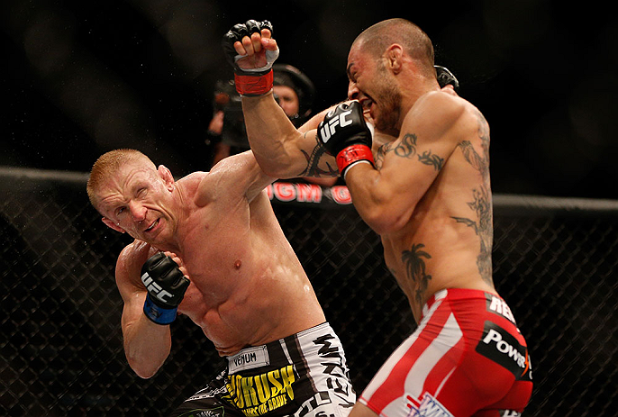 LAS VEGAS, NV - JULY 06:  (L-R) Dennis Siver punches Cub Swanson in their featherweight fight during the UFC 162 event inside the MGM Grand Garden Arena on July 6, 2013 in Las Vegas, Nevada.  (Photo by Josh Hedges/Zuffa LLC/Zuffa LLC via Getty Images) *** Local Caption *** Cub Swanson; Dennis Siver
