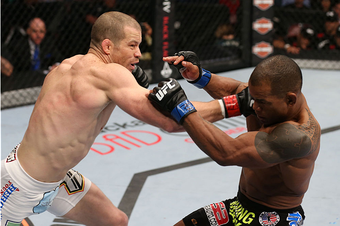 HOUSTON, TEXAS - OCTOBER 19:  (L-R) Nate Marquardt punches Hector Lombard in their UFC welterweight bout at the Toyota Center on October 19, 2013 in Houston, Texas. (Photo by Nick Laham/Zuffa LLC/Zuffa LLC via Getty Images)