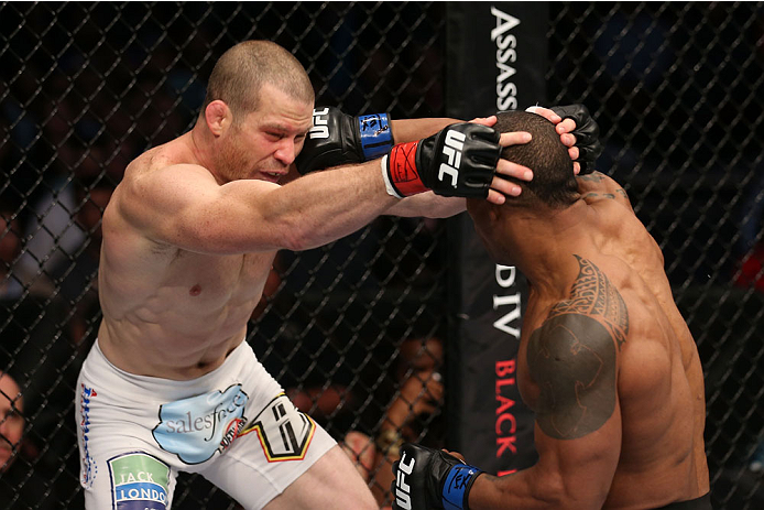 HOUSTON, TEXAS - OCTOBER 19:  (R-L) Hector Lombard punches Nate Marquardt in their UFC welterweight bout at the Toyota Center on October 19, 2013 in Houston, Texas. (Photo by Nick Laham/Zuffa LLC/Zuffa LLC via Getty Images)