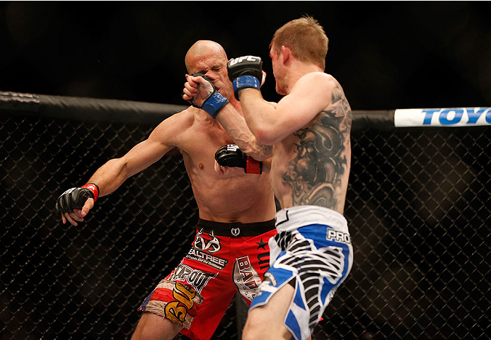 LAS VEGAS, NV - NOVEMBER 16:  (R-L) Evan Dunham punches Donald Cerrone in their lightweight bout during the UFC 167 event inside the MGM Grand Garden Arena on November 16, 2013 in Las Vegas, Nevada. (Photo by Josh Hedges/Zuffa LLC/Zuffa LLC via Getty Images) *** Local Caption *** Donald Cerrone; Evan Dunham