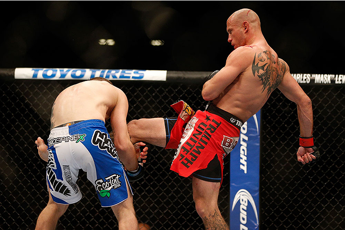 LAS VEGAS, NV - NOVEMBER 16:  (R-L) Donald Cerrone kicks Evan Dunham in their lightweight bout during the UFC 167 event inside the MGM Grand Garden Arena on November 16, 2013 in Las Vegas, Nevada. (Photo by Josh Hedges/Zuffa LLC/Zuffa LLC via Getty Images) *** Local Caption *** Donald Cerrone; Evan Dunham