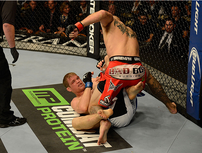 Donald Cerrone punches <a href='../fighter/Evan-Dunham'>Evan Dunham</a> during their bout at UFC 167