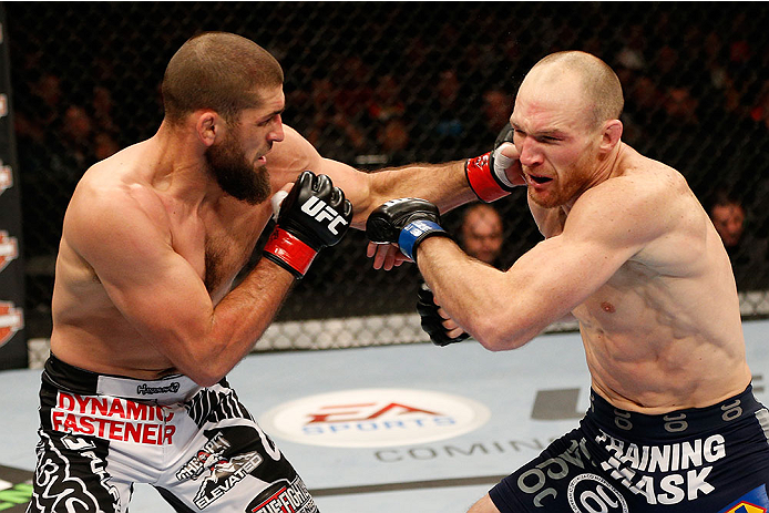 SACRAMENTO, CA - DECEMBER 14:  (L-R) Court McGee punches Ryan LaFlare in their welterweight bout during the UFC on FOX event at Sleep Train Arena on December 14, 2013 in Sacramento, California. (Photo by Josh Hedges/Zuffa LLC/Zuffa LLC via Getty Images) *** Local Caption *** Court McGee; Ryan LaFlare