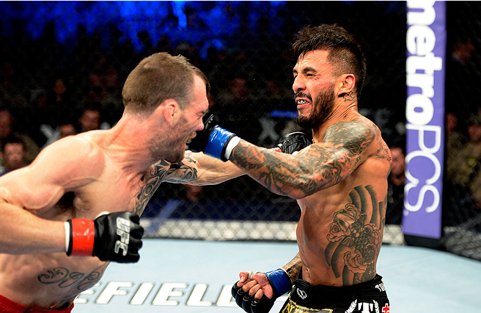 FORT CAMPBELL, KENTUCKY - NOVEMBER 6:  (L-R) George Roop punches Francisco Rivera in their UFC bantamweight bout on November 6, 2013 in Fort Campbell, Kentucky. (Photo by Jeff Bottari/Zuffa LLC/Zuffa LLC via Getty Images) *** Local Caption ***George Roop; Francisco Rivera