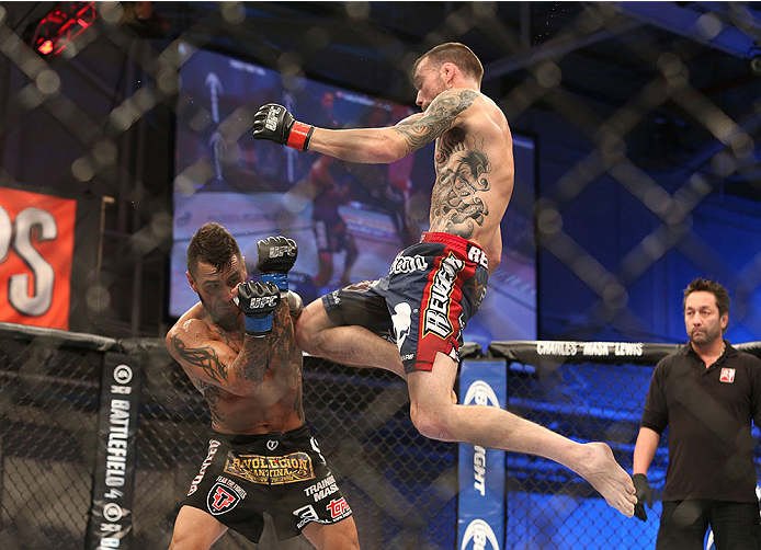 FORT CAMPBELL, KENTUCKY - NOVEMBER 6:  (R-L) George Roop knees Francisco Rivera in their UFC bantamweight bout on November 6, 2013 in Fort Campbell, Kentucky. (Photo by Ed Mulholland/Zuffa LLC/Zuffa LLC via Getty Images) *** Local Caption ***George Roop; Francisco Rivera