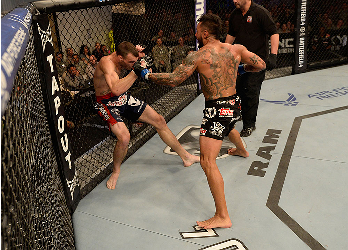 FORT CAMPBELL, KENTUCKY - NOVEMBER 6:  (R-L) Francisco Rivera punches George Roop in their UFC bantamweight bout on November 6, 2013 in Fort Campbell, Kentucky. (Photo by Jeff Bottari/Zuffa LLC/Zuffa LLC via Getty Images) *** Local Caption ***George Roop; Francisco Rivera