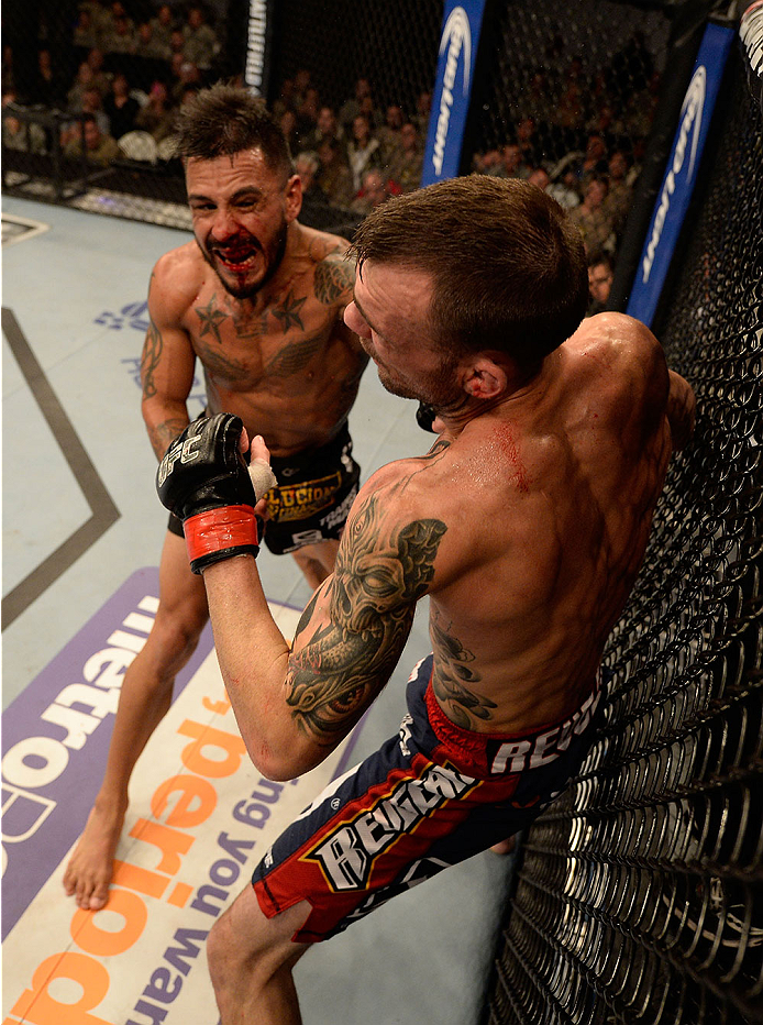 FORT CAMPBELL, KENTUCKY - NOVEMBER 6:  (L-R) Francisco Rivera punches George Roop in their UFC bantamweight bout on November 6, 2013 in Fort Campbell, Kentucky. (Photo by Jeff Bottari/Zuffa LLC/Zuffa LLC via Getty Images) *** Local Caption ***George Roop; Francisco Rivera