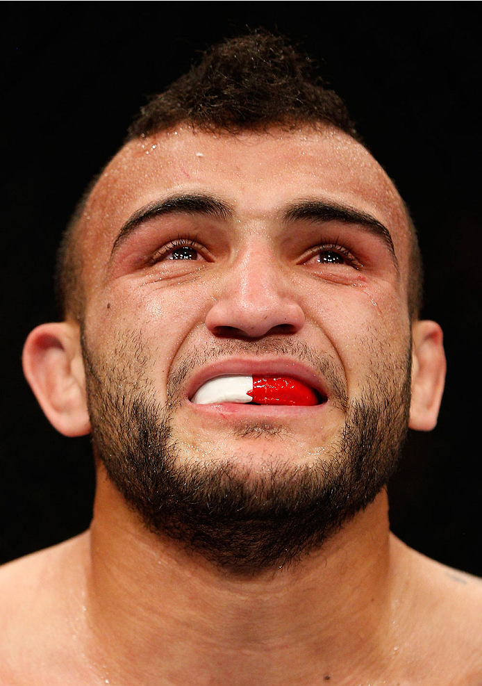 MANCHESTER, ENGLAND - OCTOBER 26:  John Lineker reacts after his knockout victory over Phil Harris in their flyweight bout during the UFC Fight Night event at Phones 4 U Arena on October 26, 2013 in Manchester, England. (Photo by Josh Hedges/Zuffa LLC/Zuffa LLC via Getty Images)