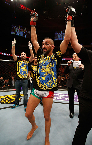 STOCKHOLM, SWEDEN - APRIL 06:  Reza Madadi reacts after his submission victory over Michael Johnson in their lightweight fight at the Ericsson Globe Arena on April 6, 2013 in Stockholm, Sweden.  (Photo by Josh Hedges/Zuffa LLC/Zuffa LLC via Getty Images)