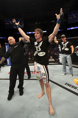 CALGARY, CANADA- JULY 21: Matthew Riddle celebrates after defeating Chris Clements during their welterweight bout at UFC 149 inside the Scotiabank Saddledome on July 21, 2012 in Calgary, Alberta, Canada.  (Photo by Nick Laham/Zuffa LLC/Zuffa LLC via Getty Images)