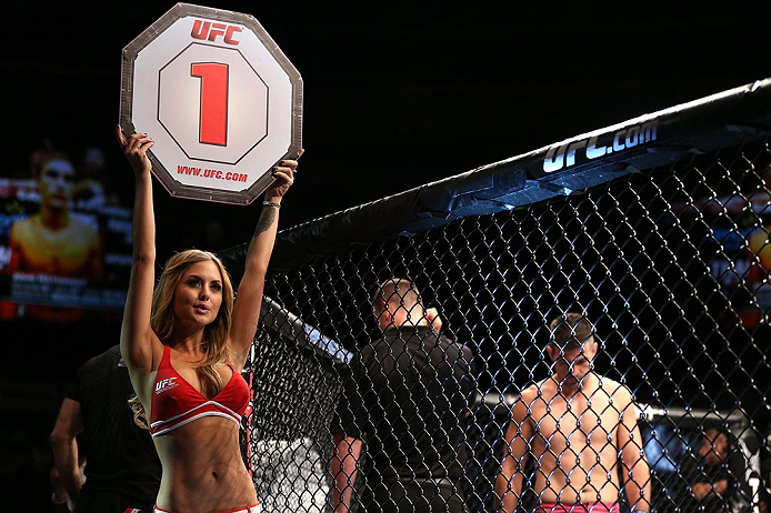 NOTTINGHAM, ENGLAND - SEPTEMBER 29:  UFC Octagon Girl Brittney Palmer introduces a bout at the UFC on Fuel TV event at Capital FM Arena on September 29, 2012 in Nottingham, England.  (Photo by Josh Hedges/Zuffa LLC/Zuffa LLC via Getty Images)