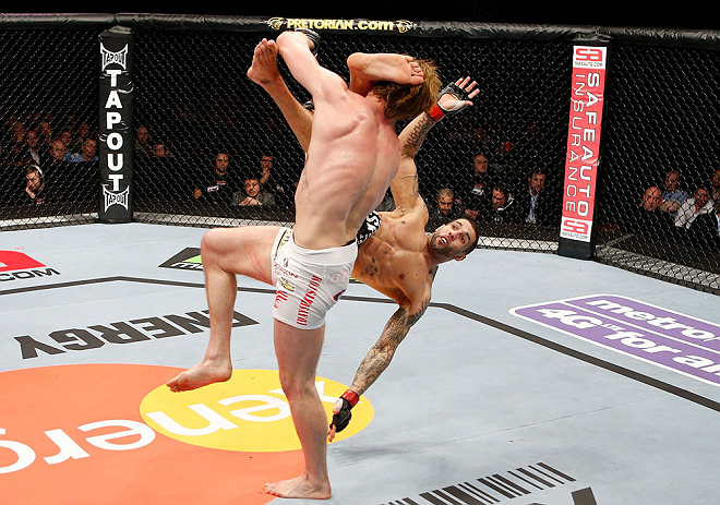 LONDON, ENGLAND - FEBRUARY 16:  (R-L) Che Mills kicks Matthew Riddle after a takedown in their welterweight fight during the UFC on Fuel TV event on February 16, 2013 at Wembley Arena in London, England.  (Photo by Josh Hedges/Zuffa LLC/Zuffa LLC via Getty Images)