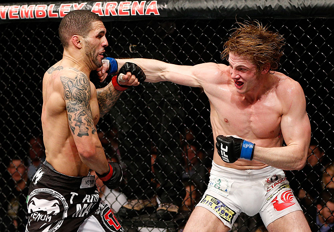 LONDON, ENGLAND - FEBRUARY 16:  (R-L) Matthew Riddle punches Che Mills in their welterweight fight during the UFC on Fuel TV event on February 16, 2013 at Wembley Arena in London, England.  (Photo by Josh Hedges/Zuffa LLC/Zuffa LLC via Getty Images)