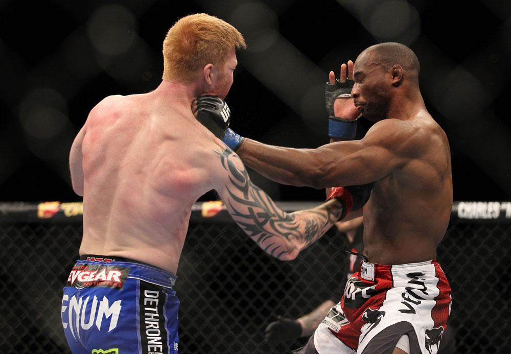 LAS VEGAS, NV - FEBRUARY 04:  Ed Herman (left) punches Clifford Starks during the UFC 143 event at Mandalay Bay Events Center on February 4, 2012 in Las Vegas, Nevada.  (Photo by Josh Hedges/Zuffa LLC/Zuffa LLC via Getty Images) *** Local Caption *** Ed Herman; Clifford Starks