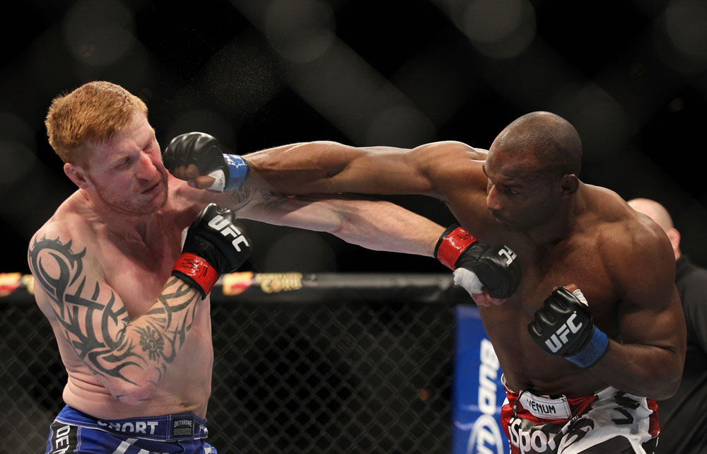 LAS VEGAS, NV - FEBRUARY 04:  (L-R) Ed Herman and Clifford Starks exchange punches during the UFC 143 event at Mandalay Bay Events Center on February 4, 2012 in Las Vegas, Nevada.  (Photo by Josh Hedges/Zuffa LLC/Zuffa LLC via Getty Images) *** Local Caption *** Ed Herman; Clifford Starks
