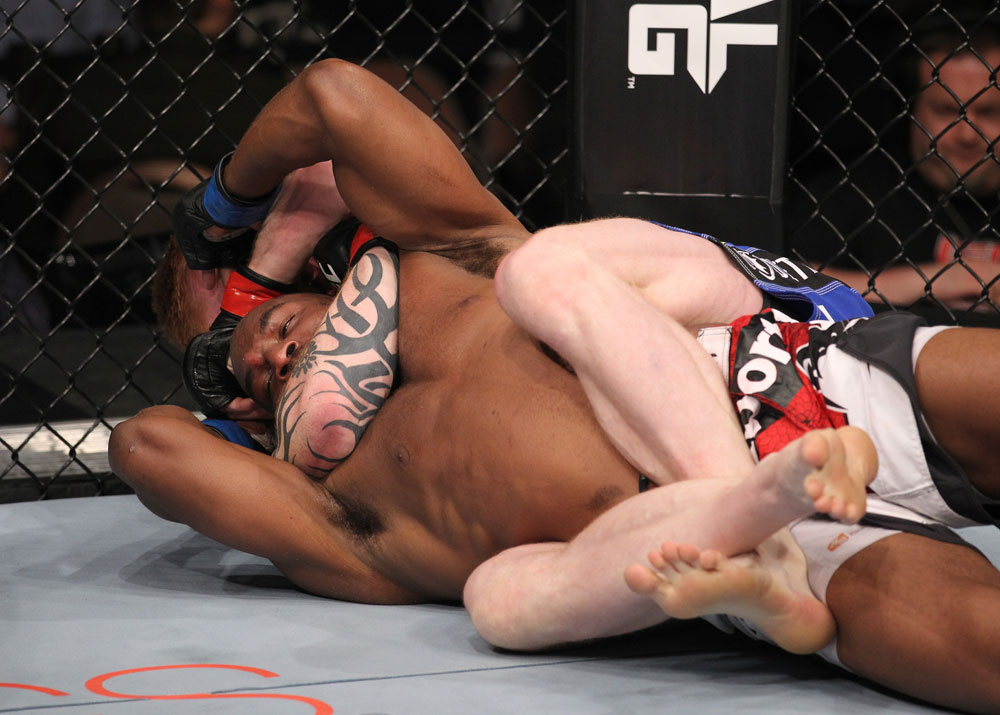 LAS VEGAS, NV - FEBRUARY 04:  Ed Herman attempts to submit Clifford Starks (red/white/black shorts) during the UFC 143 event at Mandalay Bay Events Center on February 4, 2012 in Las Vegas, Nevada.  (Photo by Nick Laham/Zuffa LLC/Zuffa LLC via Getty Images) *** Local Caption *** Ed Herman; Clifford Starks
