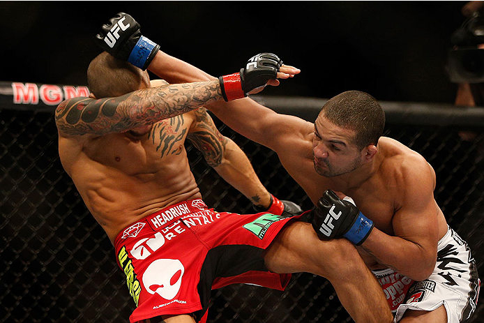 LAS VEGAS, NV - DECEMBER 28:  (R-L) Diego Brandao punches Dustin Poirier in their featherweight bout during the UFC 168 event at the MGM Grand Garden Arena on December 28, 2013 in Las Vegas, Nevada. (Photo by Josh Hedges/Zuffa LLC/Zuffa LLC via Getty Images) *** Local Caption *** Dustin Poirier; Diego Brandao