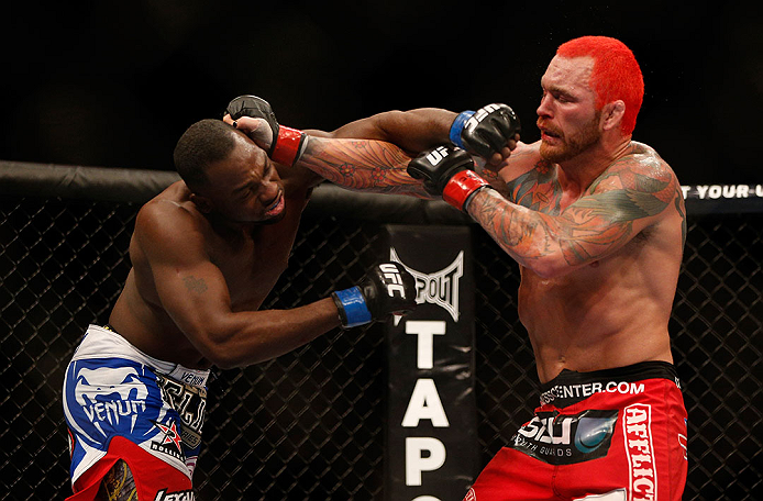 LAS VEGAS, NV - DECEMBER 29:  (R-L) Chris Leben punches Derek Brunson during their middleweight fight at UFC 155 on December 29, 2012 at MGM Grand Garden Arena in Las Vegas, Nevada. (Photo by Josh Hedges/Zuffa LLC/Zuffa LLC via Getty Images) *** Local Caption *** Chris Leben; Derek Brunson