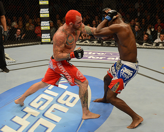 LAS VEGAS, NV - DECEMBER 29:  (L-R) Chris Leben punches Derek Brunson during their middleweight fight at UFC 155 on December 29, 2012 at MGM Grand Garden Arena in Las Vegas, Nevada. (Photo by Donald Miralle/Zuffa LLC/Zuffa LLC via Getty Images) *** Local Caption *** Chris Leben; Derek Brunson